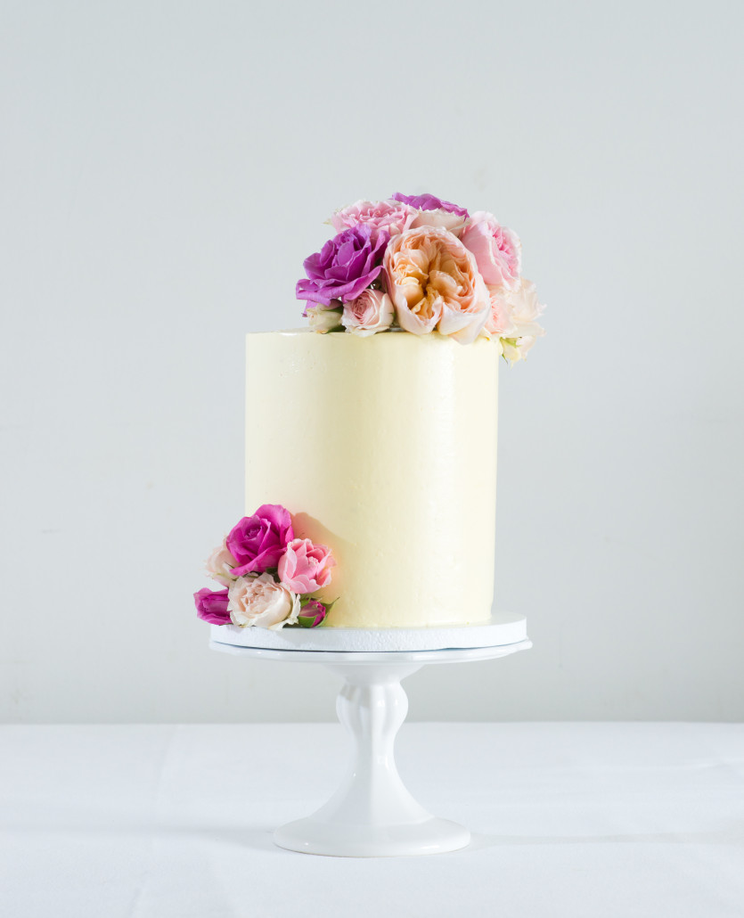 White Fondant One Tier Cake With Fresh Flowers